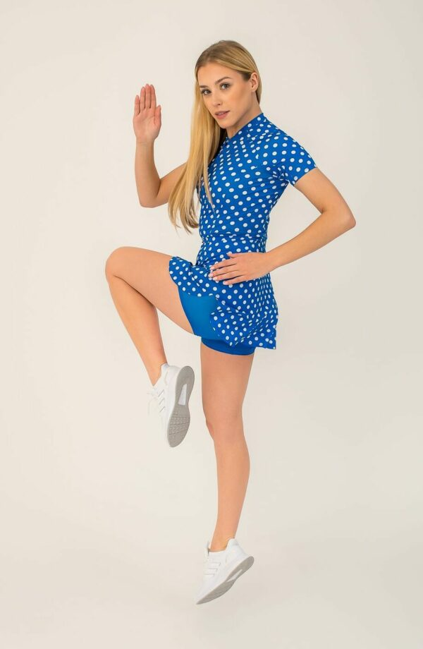 Model in High-performance multi-sport dress - polka dot, built-in shorts, phone pocket with a zipper.