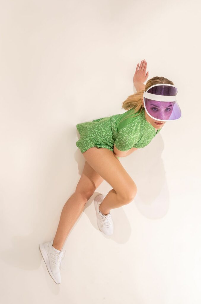 A model exercising in a dress with a phone pocket.